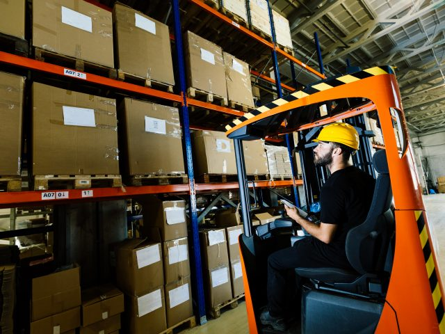 warehouse-worker-doing-logistics-work-with-forklif-GPV9KCY-640x480.jpg